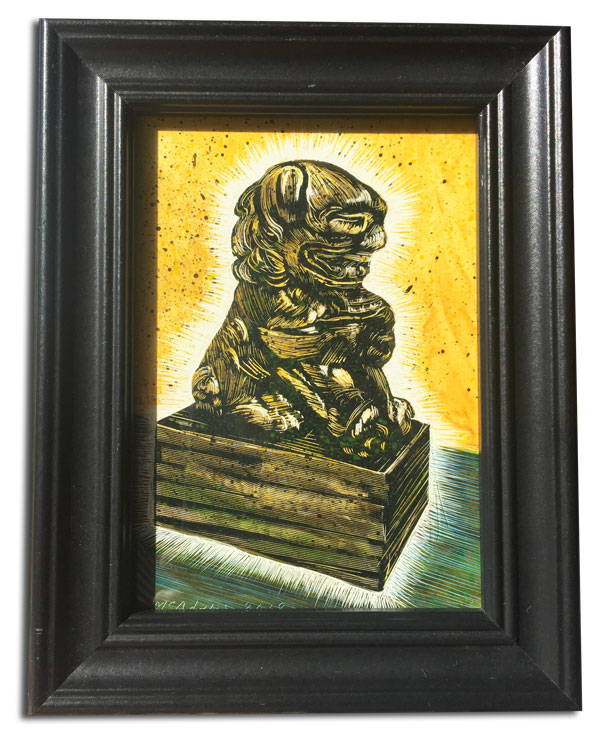 glowing foo dog with gold background rendered in scratchboard by Lori McAdams in a black frame