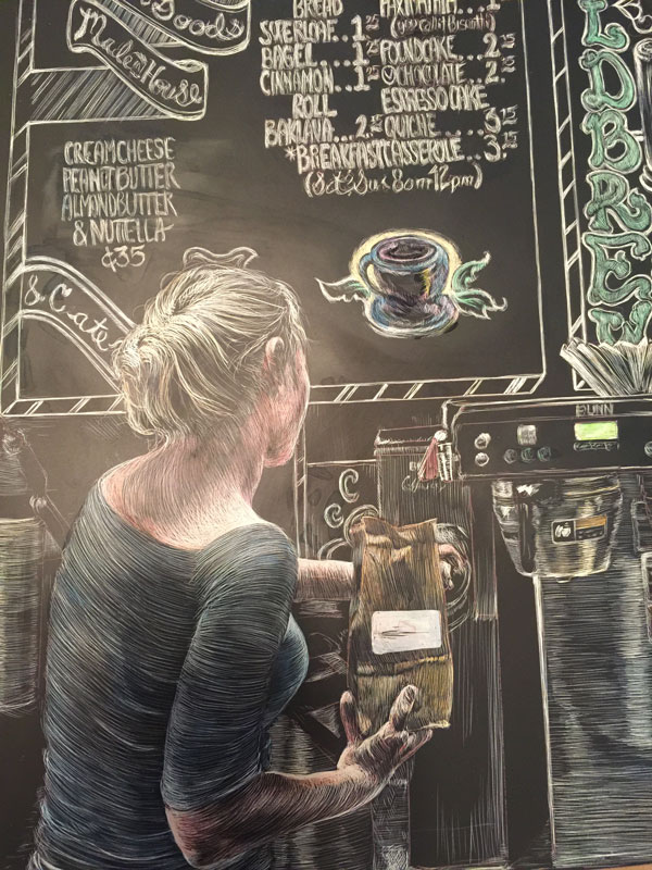 detail of woman grinding coffee rendered in scratchboard