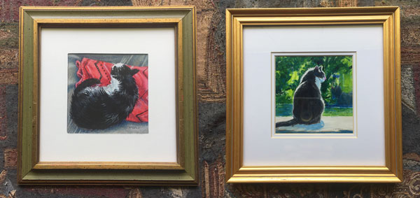 2 framed drawings of cats