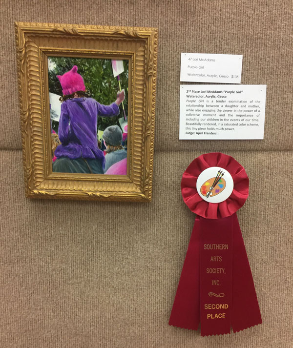 artwork with red ribbon.