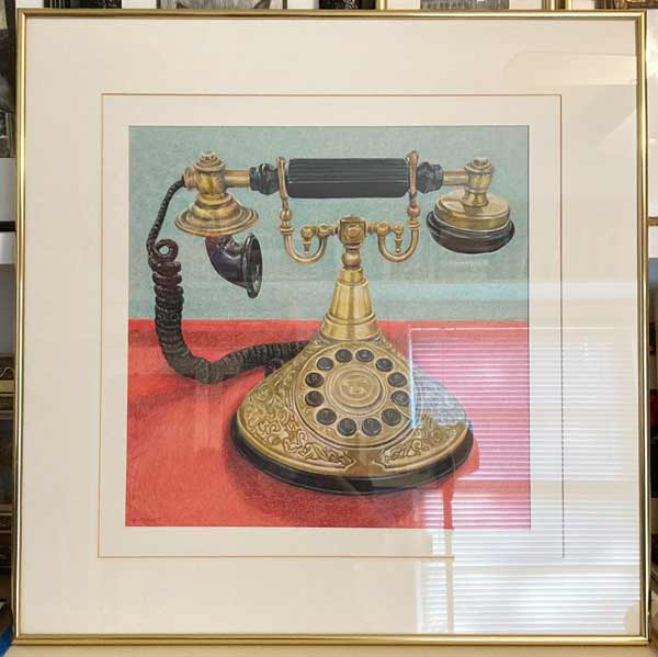 Golden ornate Princess Telephone with black speaker and dials.
